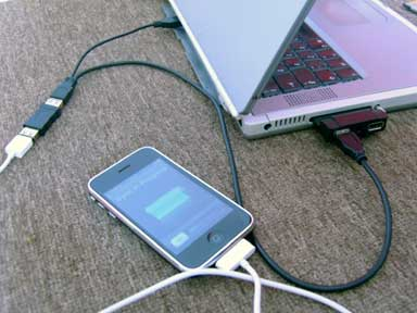 iPhone connected to USB 2.0 PC Card with USB Y-cable