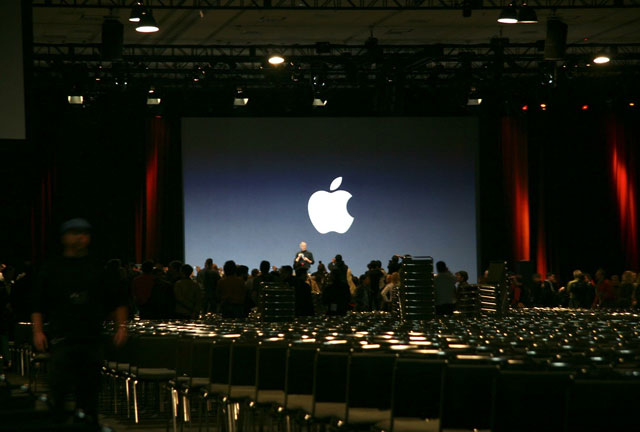 Steve Jobs poses for the cameras with the iPhone in hand at the end of his Keynote address at the Macworld Expo in San Francisco on January 9, 2007