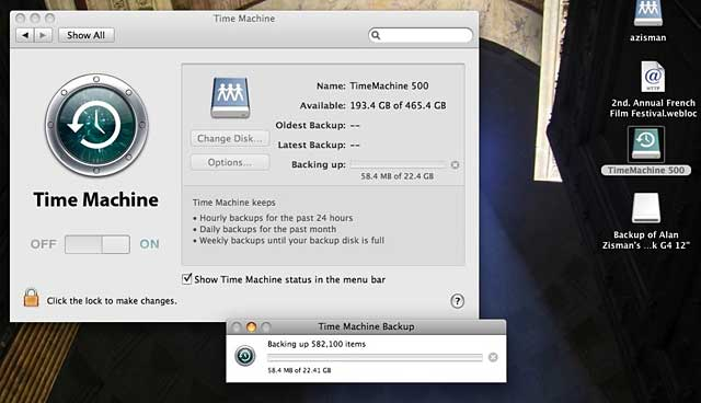 PowerBook's desktop with Time Machin ebacking up to remote volume